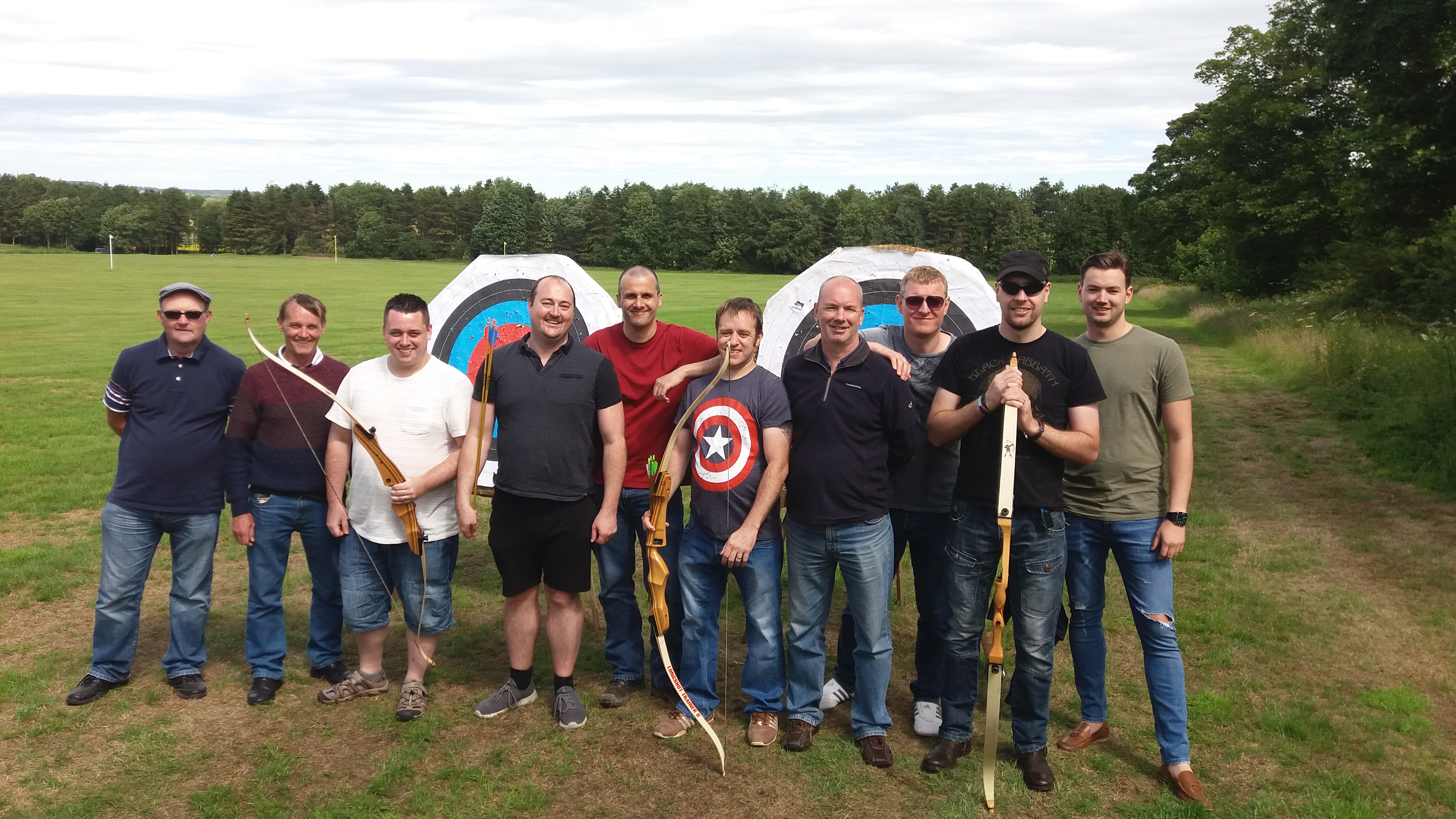 Group of men enjoying an archery session with Turboventure in Woodman's field Matfen Newcastle